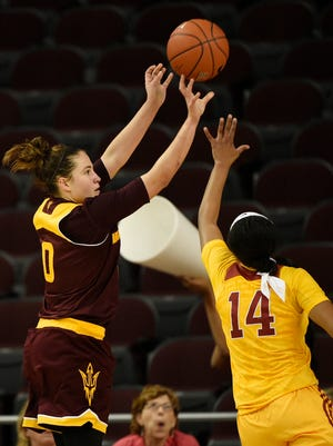 Arizona State guard Katie Hempen shoots as Southern California guard Sadie Edwards defends during the fourth quarter of an NCAA college basketball game in Los Angeles, Friday, Feb. 26, 2016. Arizona State won 50-45.