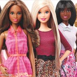 This photo provided by Mattell shows new Barbie dolls. Mattel, the toy company behind the plastic dolls, said there were some signs of improvement for Barbie after years of falling sales. The new Barbie has different ethnicities to better relate to multicultural girls and their mothers. Shares of Mattel Inc. rose 7.3 percent to $27.14 in afternoon trading Friday.