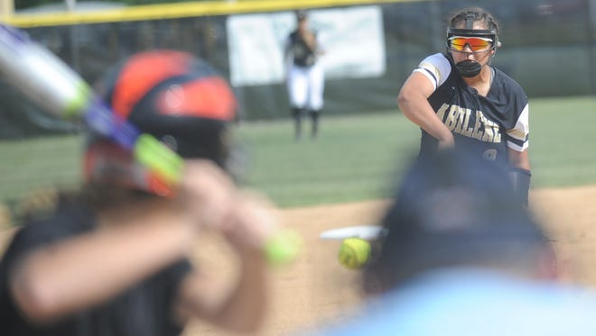 Abilene High pitcher Kaylen Washington, right, throws a pitch to a Haltom City Haltom batter in the first inning. AHS won the District 3-6A game 10-0 in five innings Thursday, April 13, 2017 at the Abilene High softball field.