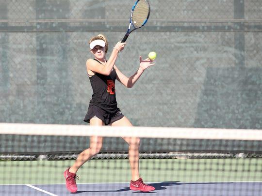 Tenaya Moranda of Palm Desert hits a shot during a singles match against Orange Lutheran, November 1, 2017.