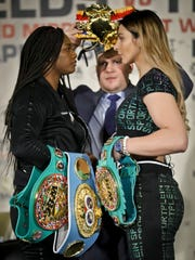 Undefeated women's middleweight world champions Claressa Shields, left, and Christina Hammer, right, face-down each other during a press conference to preview their upcoming fight, Tuesday Feb. 26, 2019, in New York. Shields and Hammer will showdown for the undisputed women's middleweight world championship in a unification bout on Saturday, April 13 in Atlantic City, N.J. (AP Photo/Bebeto Matthews)