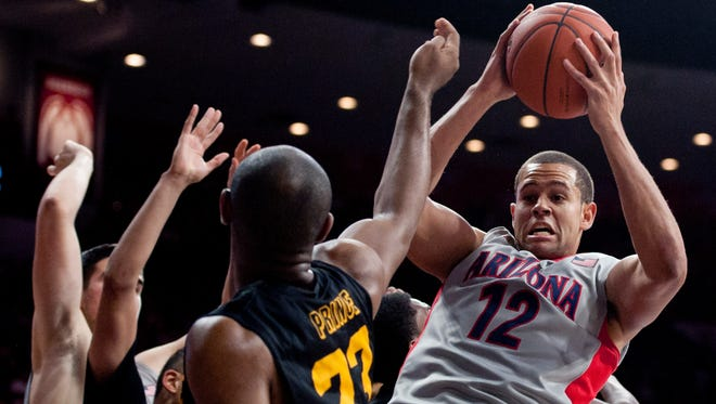 Dec. 22, 2015; Tucson; Arizona Wildcats forward Ryan Anderson (12) grabs the rebound over Long Beach State 49ers forward Roschon Prince (23) during the second half at McKale Center.
