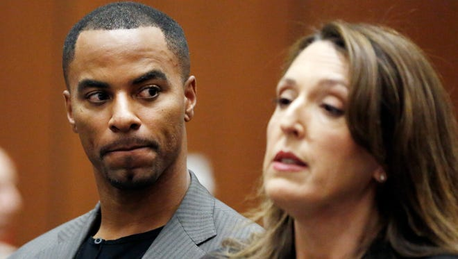 Former NFL safety Darren Sharper, shown here in a file photo with his attorney Blair Berk during a previous appearance in Los Angeles Superior Court, is likely to remain in jail after an Arizona judge ruled Thursday he should have no bond set in connection with one of two rape charges against him stemming from an incident last November in Tempe.  where he pleaded not guilty Thursday, Feb. 20, 2014, to charges of drugging and raping two women. Sharper's bail has been increased from $200,000 to $1 million. (AP Photo/Mario Anzuoni, Pool) ORG XMIT: LA114