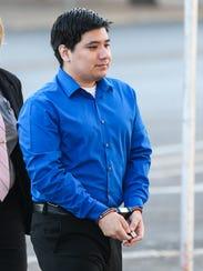 Isidro Miguel Delacruz arrives for his trial Thursday,