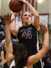 Bearden's Grace van Rij takes a shot while defended by Oak Ridge's Mykia Dowdell during a Region 2-AAA girls basketball tournament game at Oak Ridge High School between Oak Ridge and Bearden om Friday.