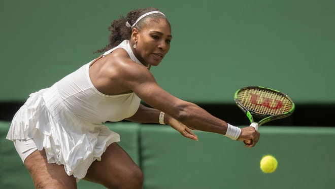Serena Williams  hits a return during her match against Amra Sadikovic of Switzerland on day two of the 2016 The Championships Wimbledon  at the All England Lawn Tennis and Croquet Club.