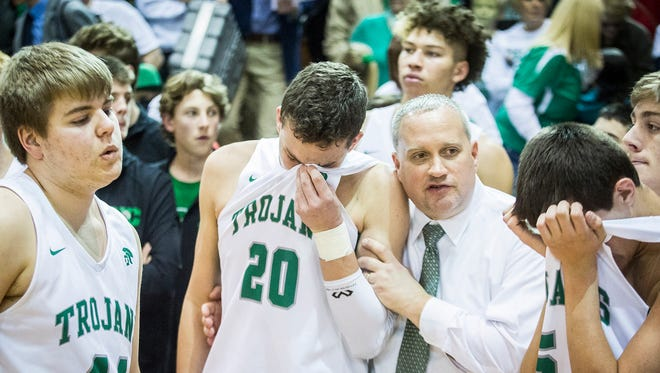 New Castle reacts after losing to Culver in their semi-state game at Lafyette-Jeff High School Saturday, March 17, 2018.