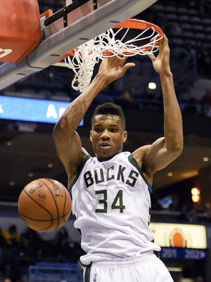 Milwaukee Bucks forward Giannis Antetokounmpo (34) dunks in the third quarter during the game against the Denver Nuggets at BMO Harris Bradley Center. The Bucks beat the Nuggets 92-74.