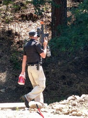 An officer arrives with nonlethal bullets to move the