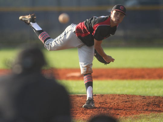NFC's Matthew Dickey pitches in relief against Maclay.