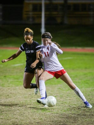 Jane Jordan dribbles the ball past the midfield. Palm Desert beats Cathedral City during their home game 5-3.