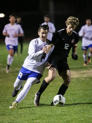 Vincenzo Costagliola steals the ball from Cathedral City. Cathedral City topped Palm Springs 3-1.
