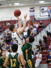 Bryan Talley scores one for the Rattlers in the team's win over Coachella Valley Tuesday night.