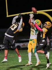 Both team fights for the ball at the end zone. The Coachella Valley varsity football team won Thursday's away conference game against Yucca Valley by a score of 29-28.