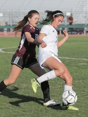 Adrianna Moreno (right) of the Coachella Valley soccer team controls the ball against University Prep (Victorville) on Thursday in a CIF playoff game.