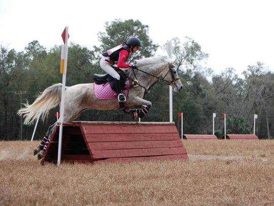Ava Rickert, riding A Magical Unicorn, looks toward