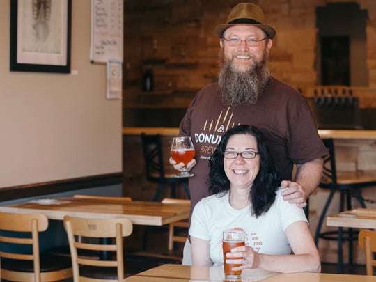 Brewer Kim and Rick of Donum Dei Brewery used a $5,000 loan to purchase an additional fermentation vessel to double production and start selling their beer to restaurants.
