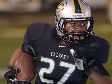 Calvary's Kyle Jones runs with the ball in a Cavalier playoff contest.