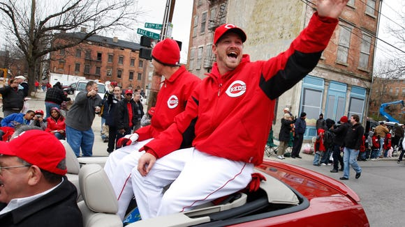 Reds pitcher Travis Wood waves to fans during the Opening Day parade in 2011.