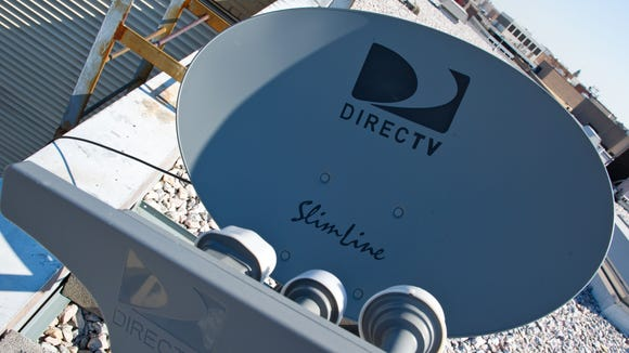 This May 19, 2014, file photo shows a satellite dish belonging to DirecTV in Washington, DC.