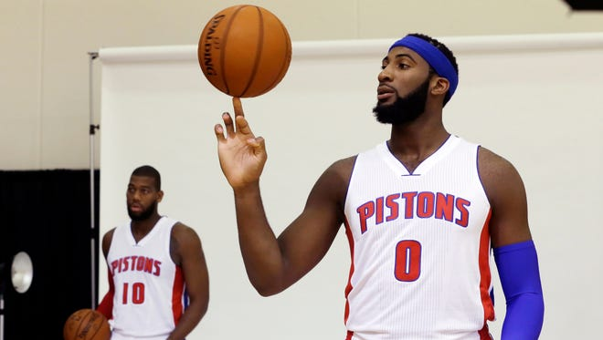 Detroit Pistons center Andre Drummond, right, stands next to forward Greg Monroe during media day Sept. 29, 2014.