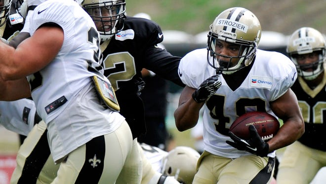 Saints RB Derrick Strozier (48) looks for a running lane during training camp at The Greenbrier.