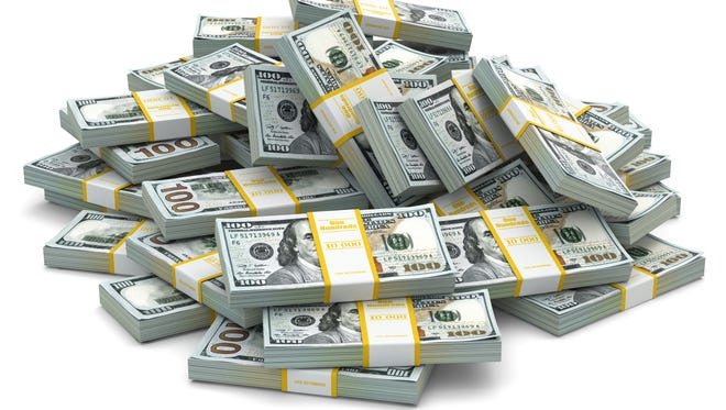 Getty Images/iStockphoto Heap of packs of dollars. Lots of cash money.3d