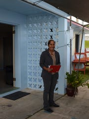 Micronesian Resource Center One-Stop Shop Project Director Sylvia Elias talks about the services the center provides during an opening ceremony for the building. The center is located at the Peter Mark Cruz Youth Center in Yoña.