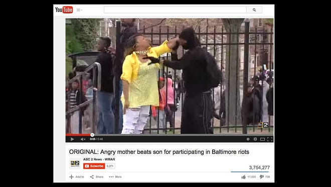 Baltimore mom Toya Graham stops her son from participating in the city's riots.