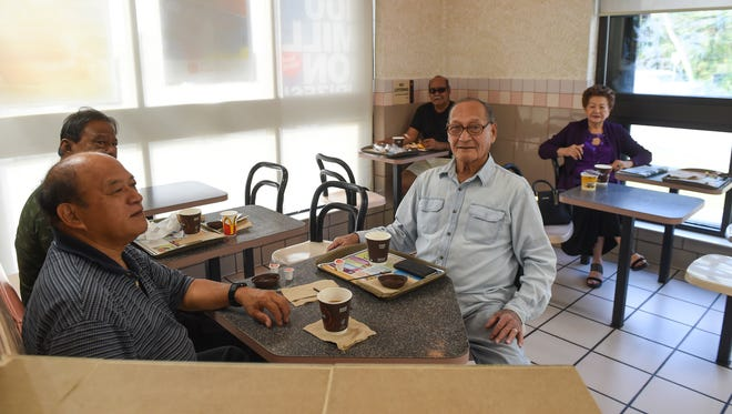 A group of manåmko friends have breakfast together at McDonald's in Hagatna on April 9.