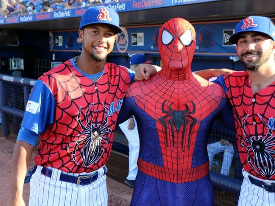 """""""Spidey"""" poses with members of the St. Lucie Mets at the 2018 """"Be A Hero"""" night benefiting Voices for Children."""