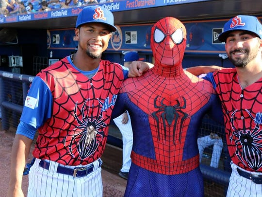 'Spidey' poses with members of the St. Lucie Mets roster on 'Be A Hero' night.