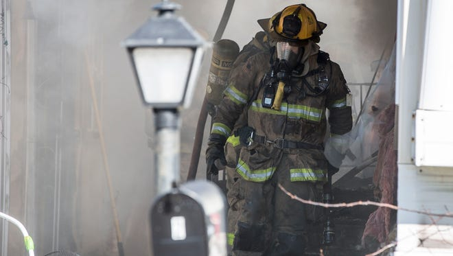 Firefighters battle a blaze at the Muncie Mobile Home Park on Feb. 26 as a mobile home near the entrance of the neighborhood caught fire. No one was home at the time of the fire, and the cause is still under investigation.