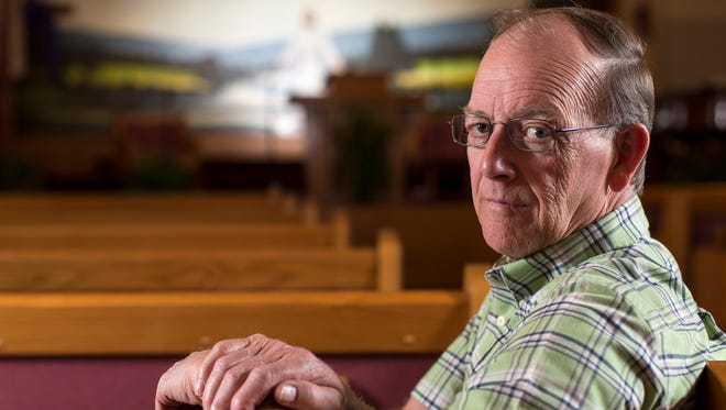 Pastor Phil Fulton poses for a portrait in the sanctuary of the Union Hill Church in Adams County, Ohio, on Tuesday, April 26, 2016. Fulton and his church gave support to the Rhoden and Manley families following the Pike County murders on Union Hill Road.