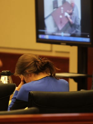 Shayna Hubers, 24, scribbled notes on a legal pad during the testimony Tuesday, and could be seen sinking her head into her hands at one point.