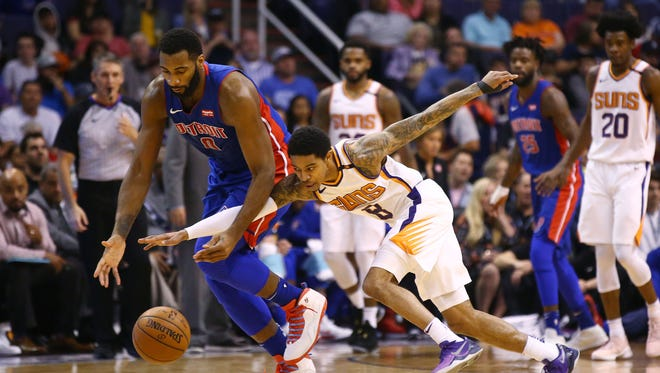 Detroit Pistons' Andre Drummond knocks the ball away from Phoenix Suns' Tyler Ulis in the second half on Mar. 20, 2018 at Taking Stick Resort Arena in Phoenix, Ariz.