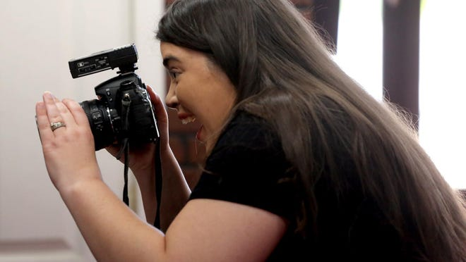 Miranda Byrd takes photos at her studio on Tuesday. Picture Perfect Portrait Studios is located at 1625-1 E. Dixon Blvd. in Shelby.