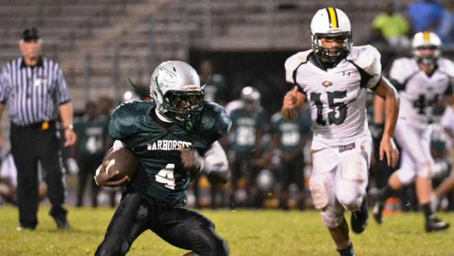 Peabody senior receiver/cornerback Eriel Dorsey (4) and the Warhorses seek a second straight victory over Alexandria Senior High Friday night after not beating the Trojans for 23 years prior to last season.