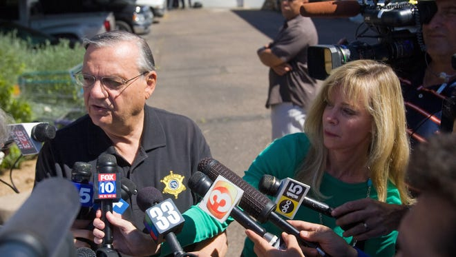 Sheriff Joe Arpaio  talks with the media after an immigration raid in west Phoenix on May 6, 2010.