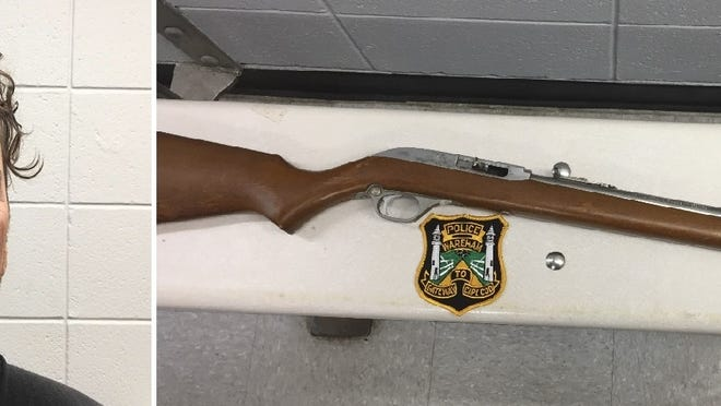 Gregory W. Schroth was arrested for using this rife to fire shots at two police officers and two civilians.