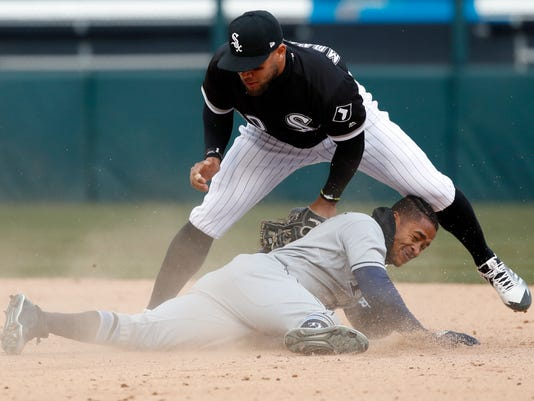 Chicago White Sox second baseman Yoan Moncada, top, tags out Tampa Bay Rays Mallex Smith during the ninth inning of a baseball game in Chicago, on Tuesday, April 10, 2018. The Rays won the game 6-5. (AP Photo/Jeff Haynes)