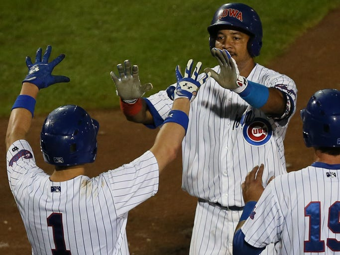 Manny Ramirez is congratulated on his home run in the bottom of the seventh inning during his first game with the Iowa Cubs as they play Omaha Monday, June 30, 2014.