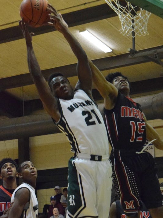 Rapides' Dorian Blue (21, left) comes up with a rebound against Many's Jeffrey Frazier (15, right).