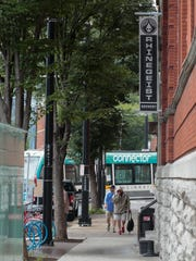The Cincinnati Bell Connector Streetcar turns onto