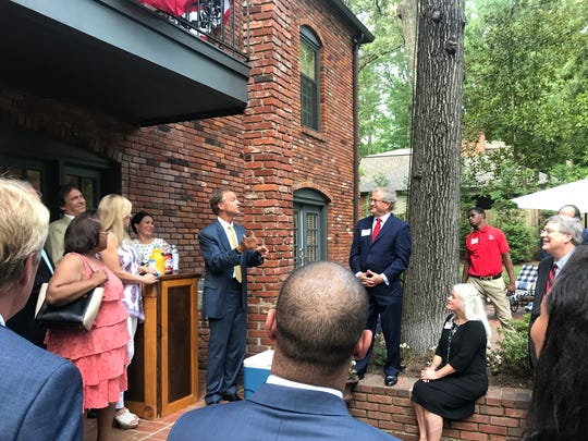 Tennessee Gov. Bill Haslam (background, left) says he's he's never been more encouraged about Memphis' prospects. Haslam was at a fundraiser for Memphis Republican Rep. Mark White (background, right) on June 13, 2018, in Memphis.