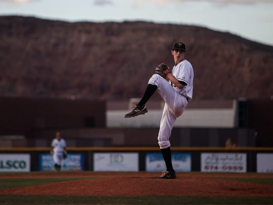 Former Desert Hills pitcher Dylan File winds up to pitch against Cedar on Tuesday, April 1, 2014.