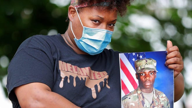 Tymica Dorsey of Akron shows a portrait Thursday of her 20-year-old son, Joziah, who was quarantined at Fort Campbell, Ky., with coronavirus.
