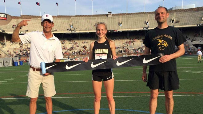Jessica Lawson after her win in the high school girls 3,000 Thursday at the Penn Relays at Franklin Field in Philadelphia. To her left is her father, Ray Lawson.