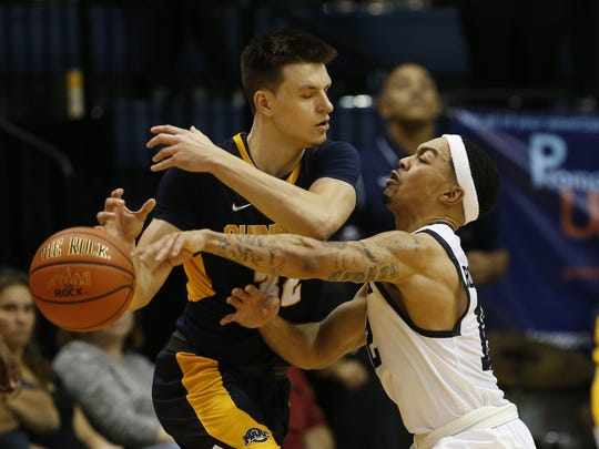 Pete Kiss (left), while at Quinnipiac, guarded by Monmouth's Justin Robinson