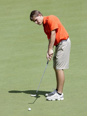 Mishicot's Austin Schnell rolls a putt toward the hole during the first round of the WIAA State Golf Tournament at University Ridge June 6.